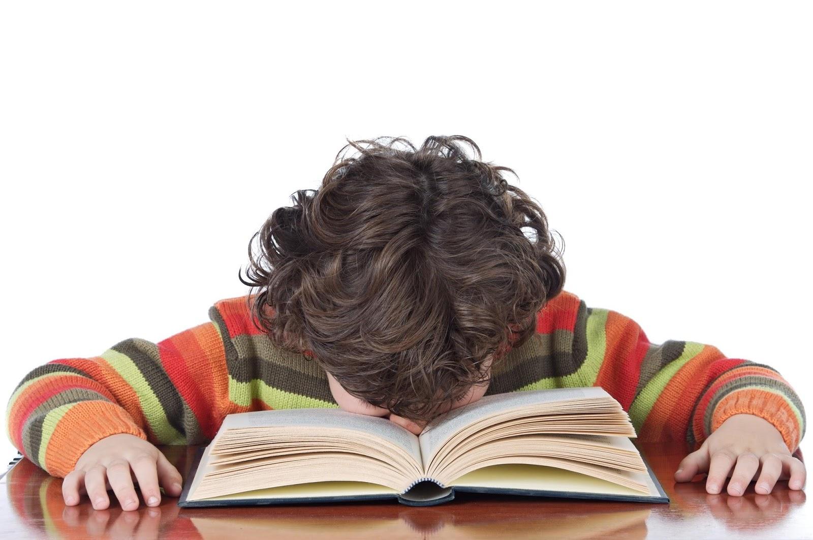 kid sleep on book